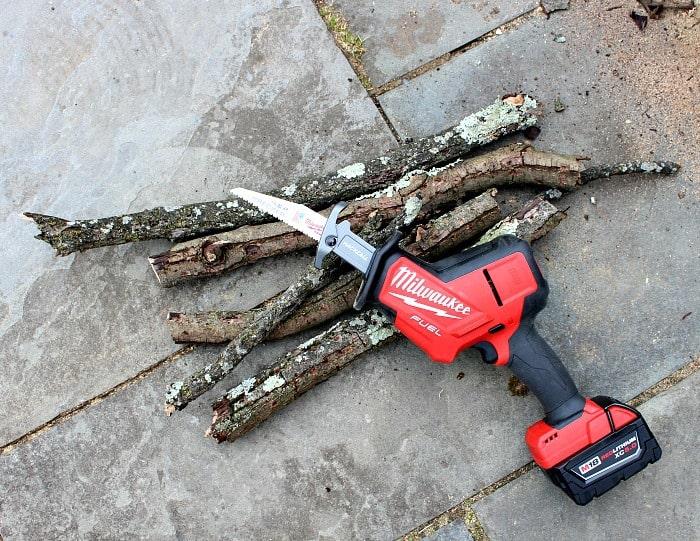 Milwaukee Hackzall cutting tree limbs