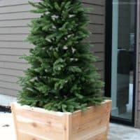 artificial tree in cedar planter