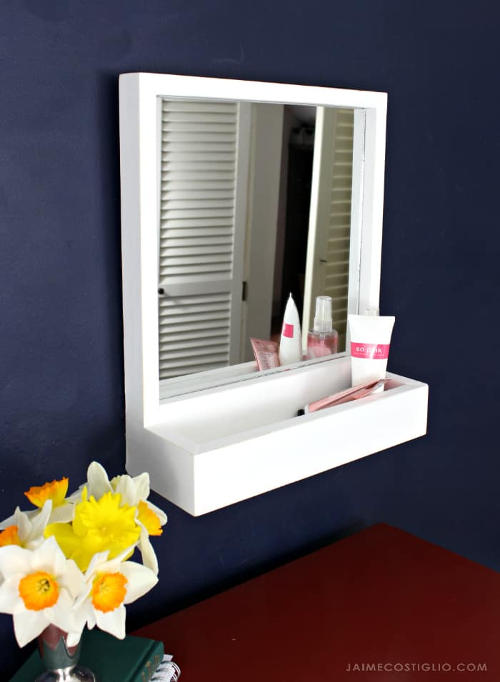 mirror with storage compartment