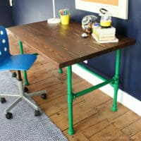 varathane stained desk top with painted pipe base feature