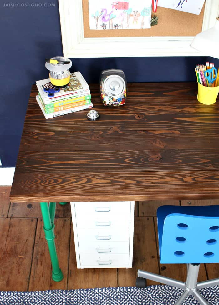 varathane stained wood desk top with pipe base 1