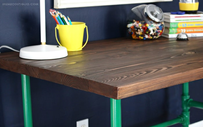 varathane stained wood desk with painted pipe base detail