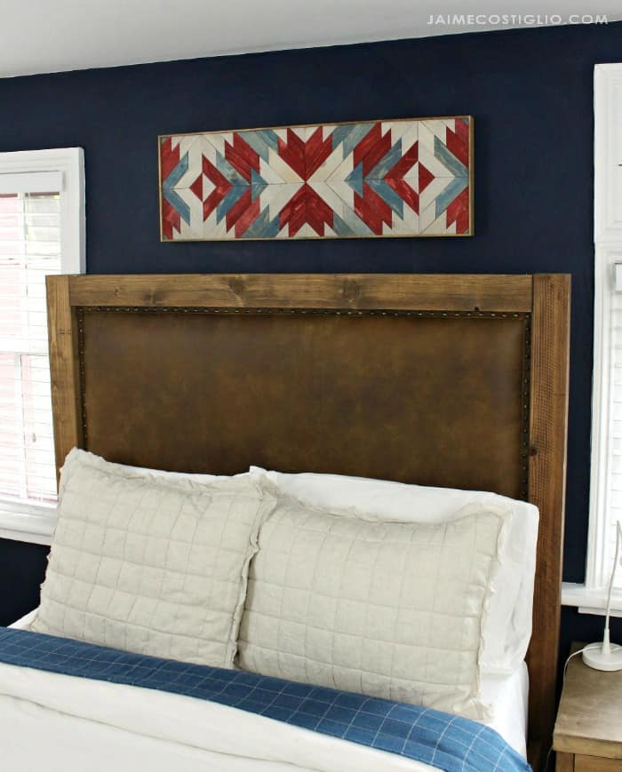 stained wall art with leather headboard