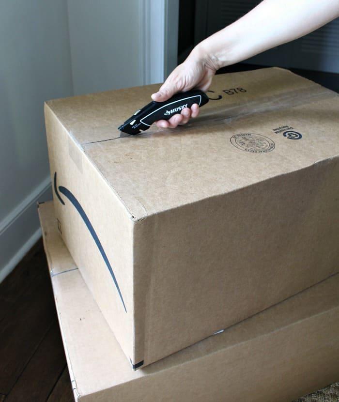 Husky utility knife cutting cardboard box