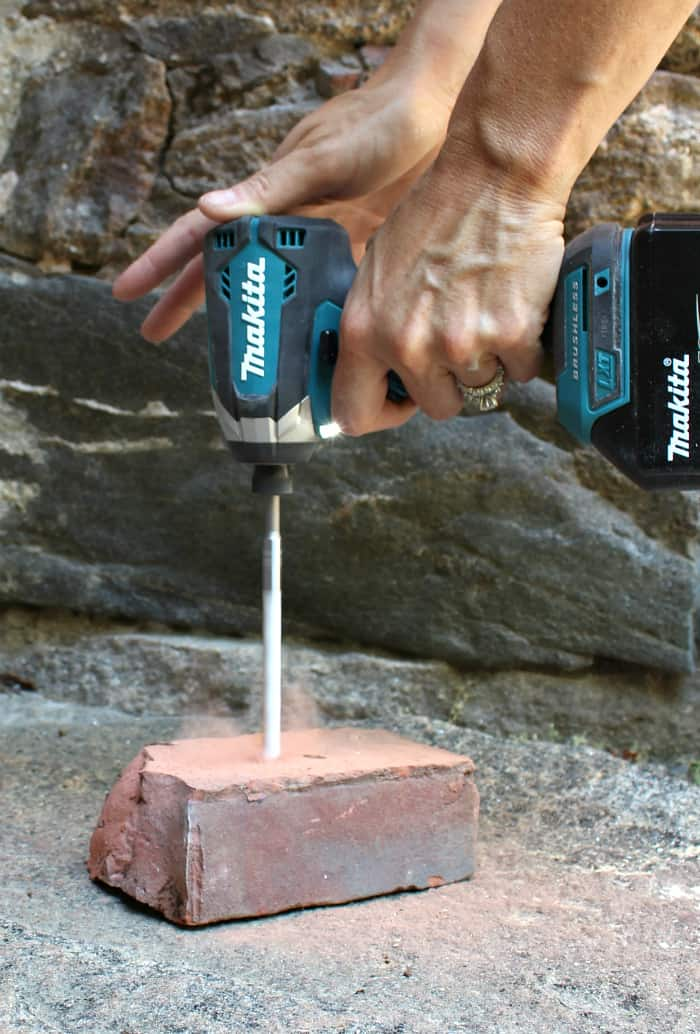 Bosch carbide drill bit into brick