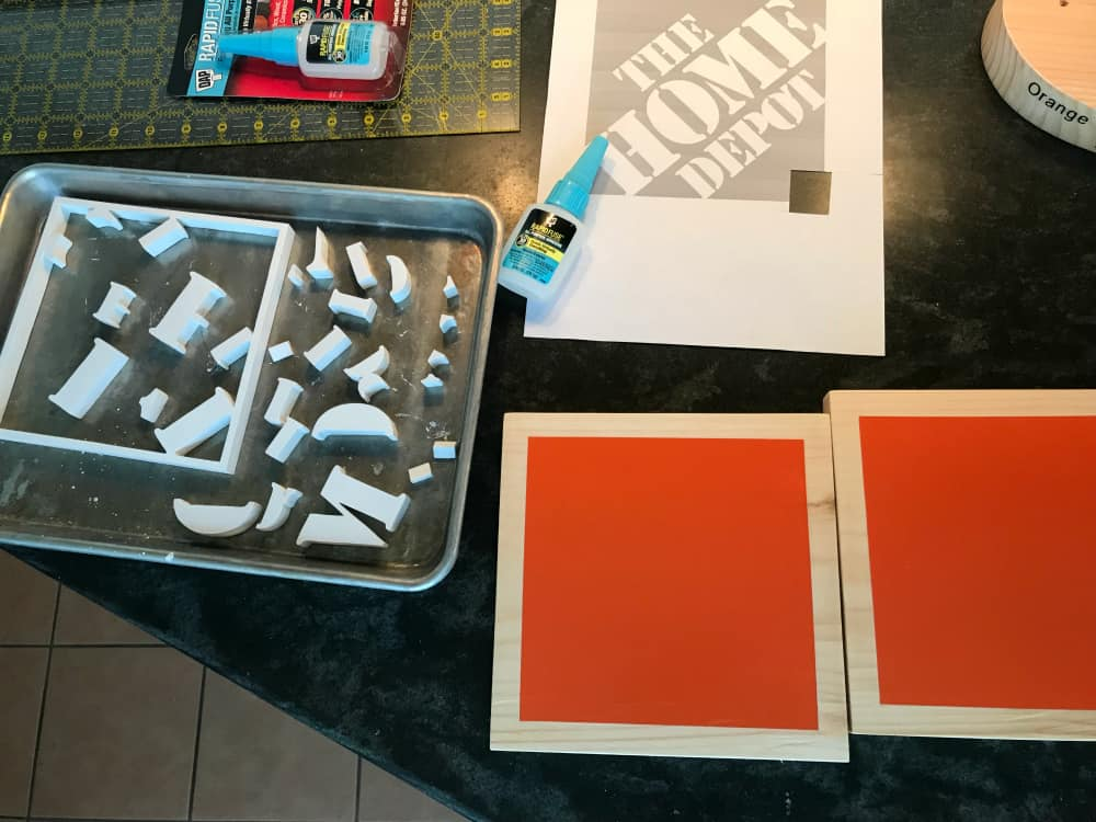 assembling the home depot logo trophy