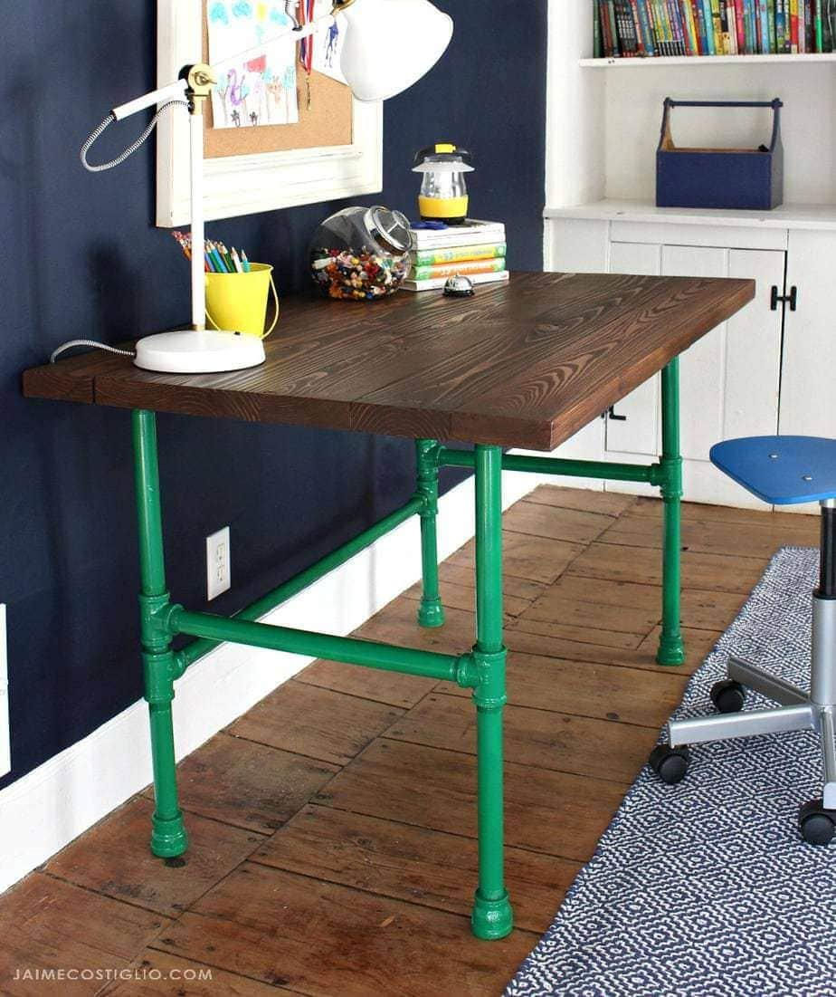 wood desk with pipe base
