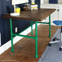 wood desk with pipe base feature