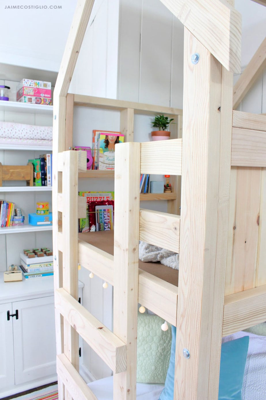 kids playhouse loft with guardrail and ladder