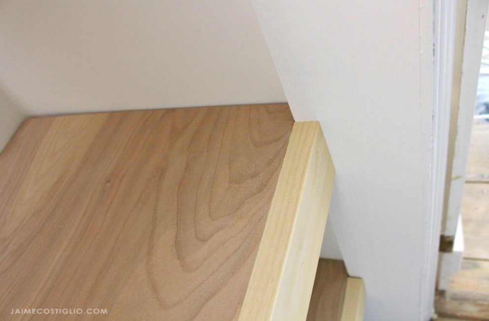 plywood shelves at door trim