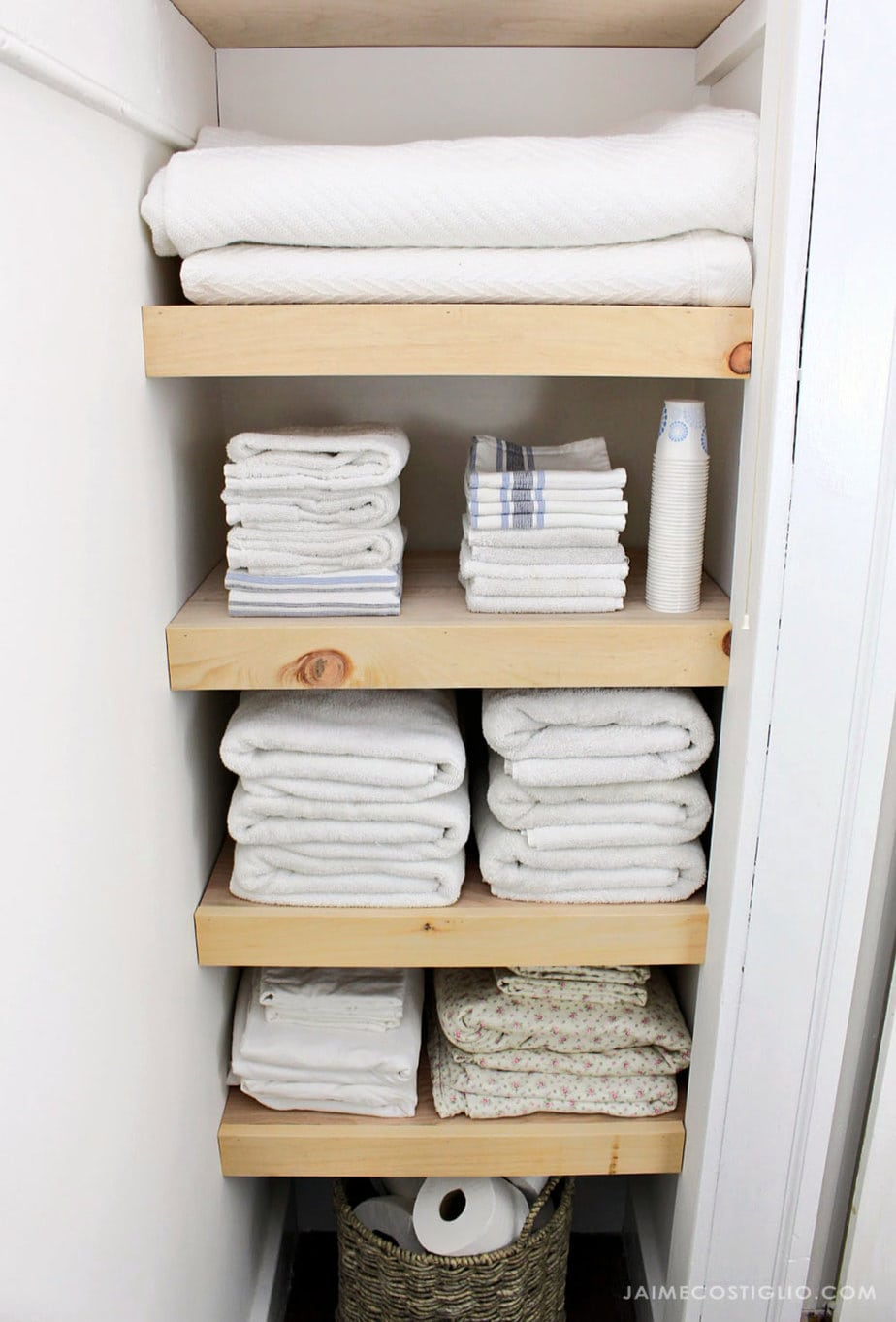 plywood shelves with linens