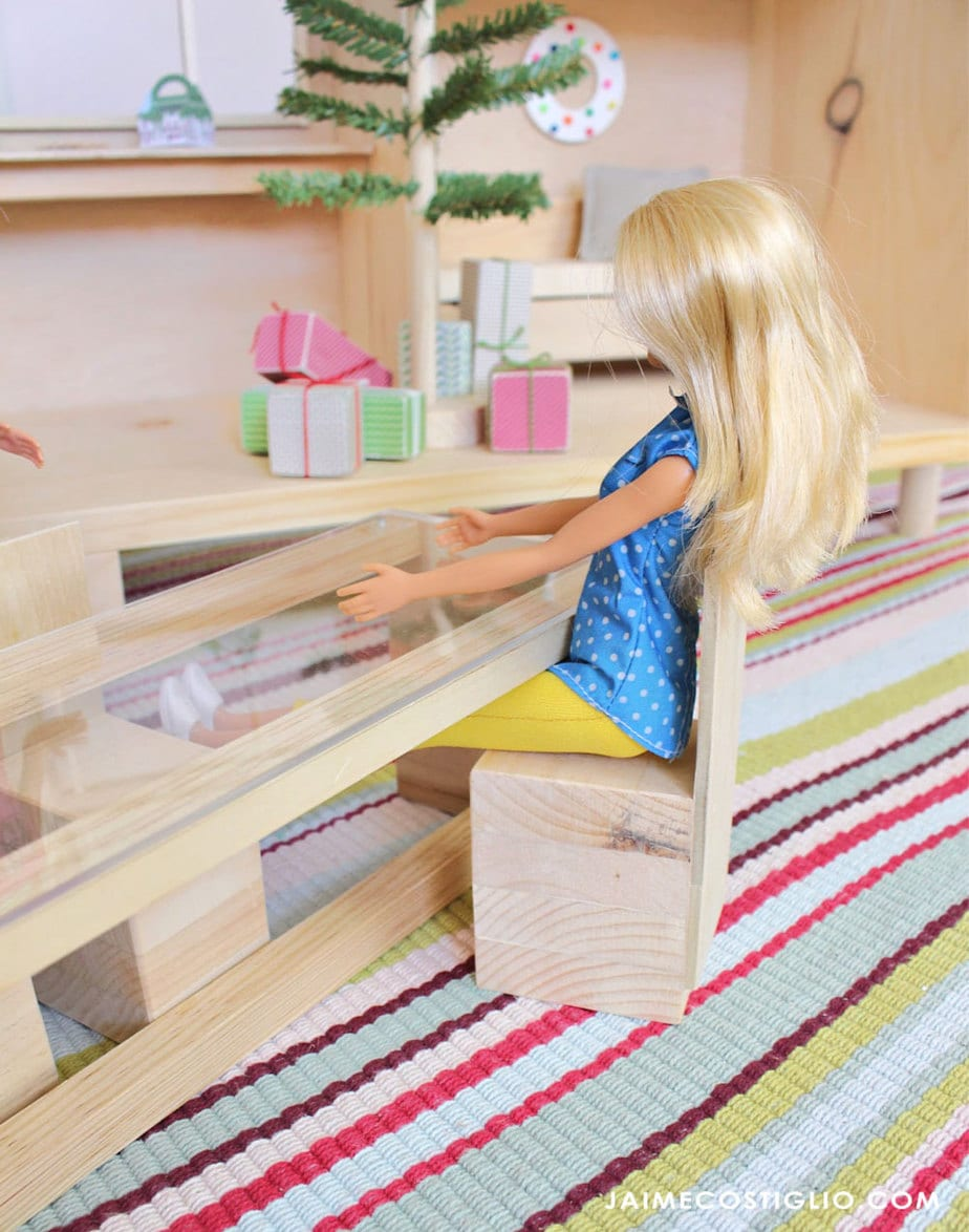 barbie sitting in tiny house dining chair