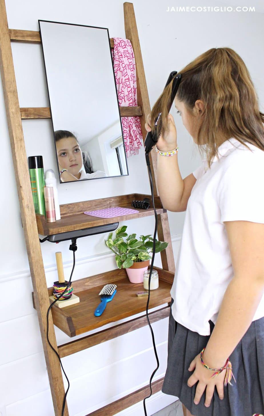 teenager leaning vanity