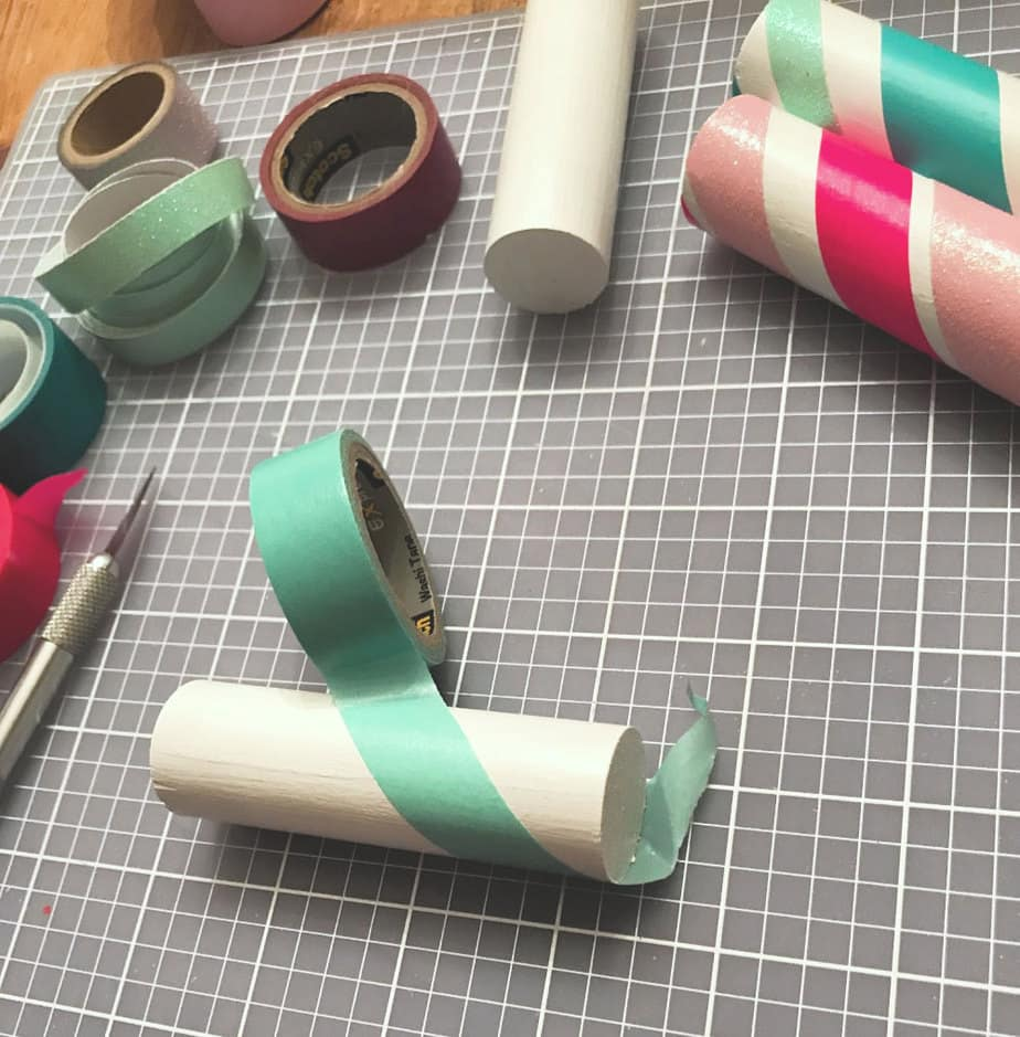 wrapping washi tape around wood dowel