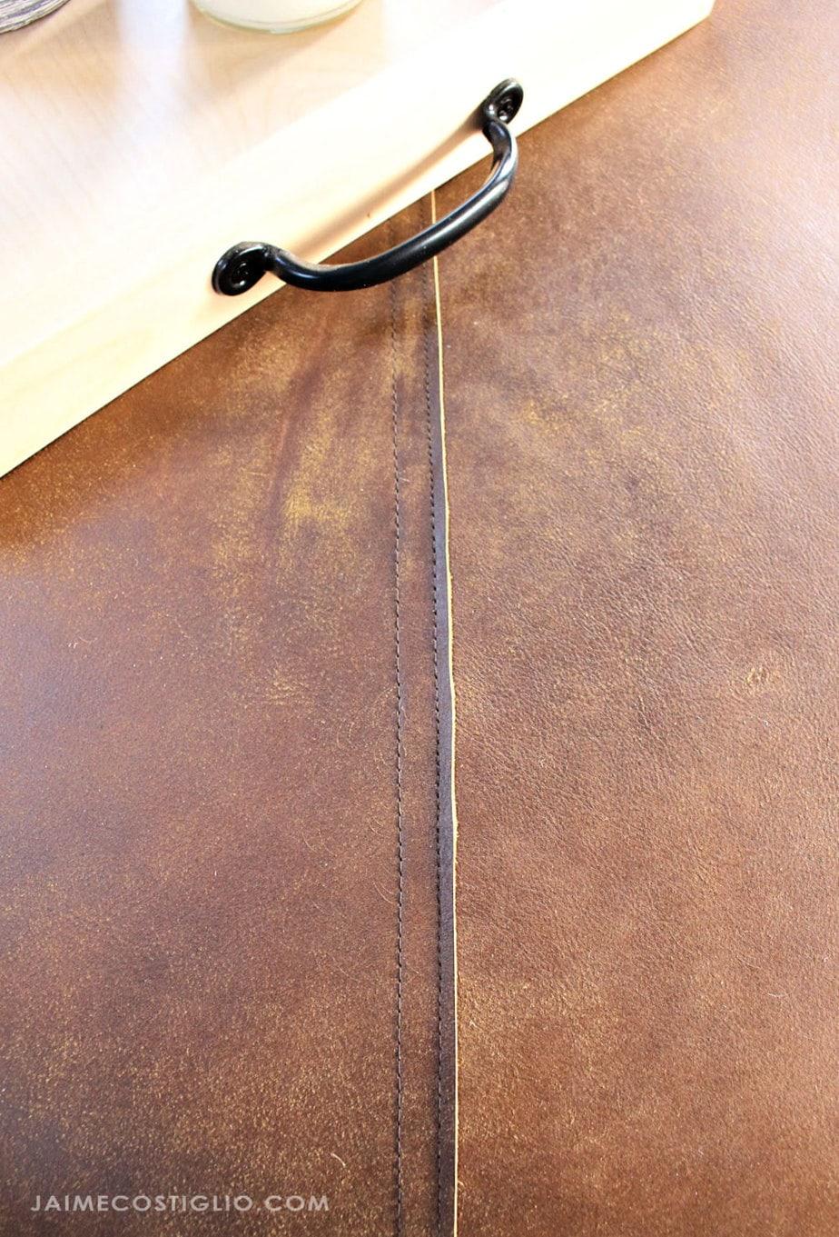 round leather ottoman seam detail
