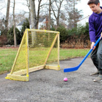 street hockey goal with boy