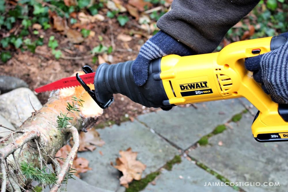 dewalt recip saw cutting tree trunk