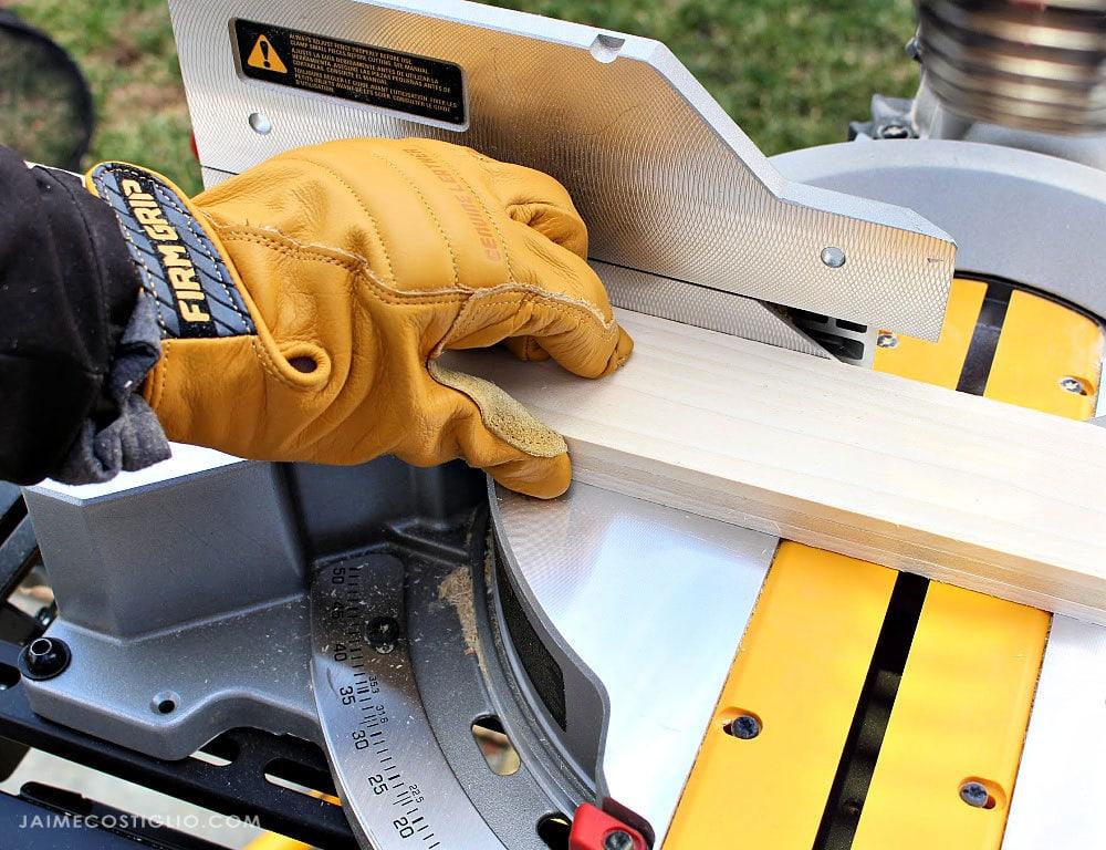 firm grip gloves holding lumber