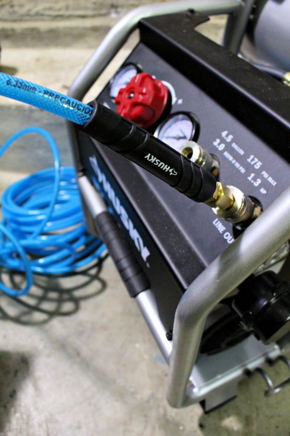 husky air compressor with hose attached