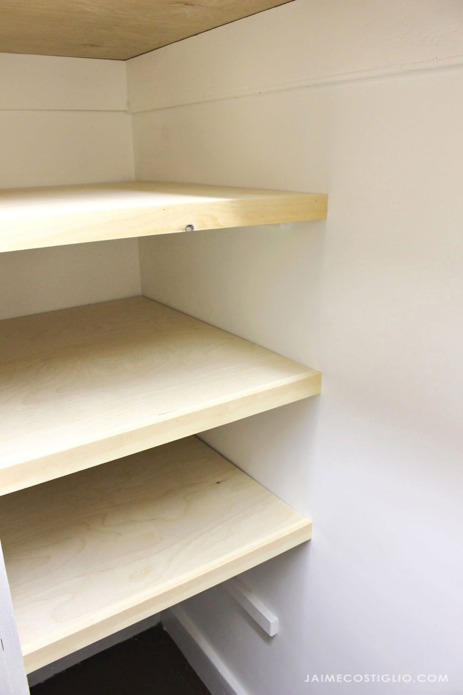 linen closet shelves with trim