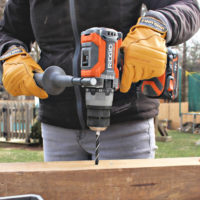 ridgid hammer drill drilling into wood