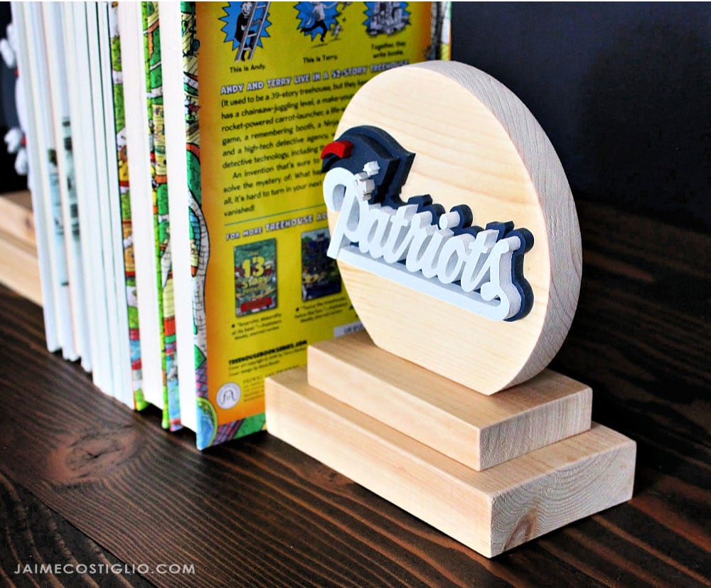 scrolled wood bookend with patriots logo