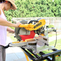 cutting a board on the miter saw