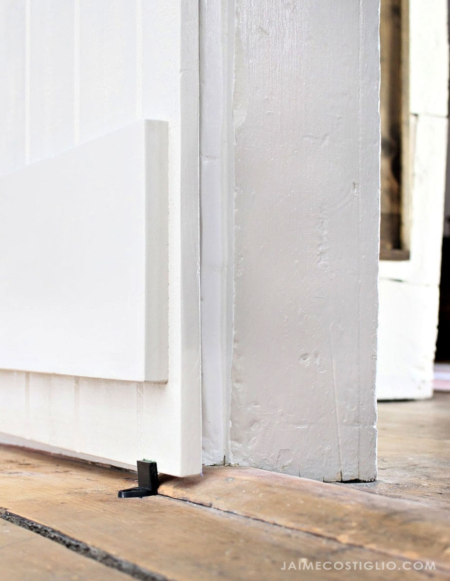 sliding barn door bottom door guide