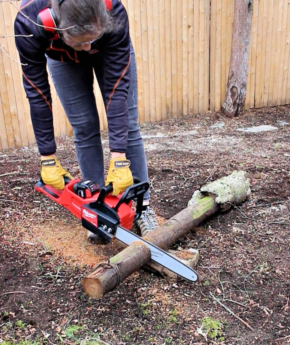cutting log with chainsaw