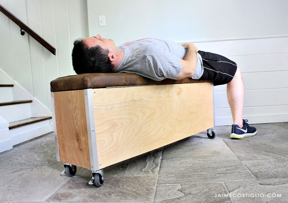 6 foot male laying on workout bench