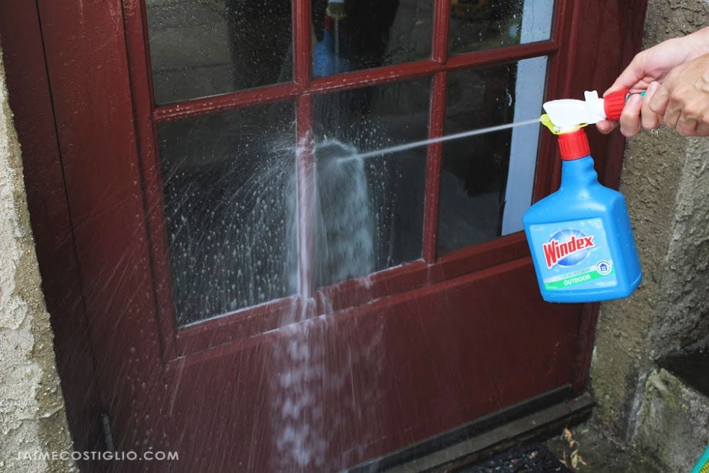 cleaning storm window with windex outdoor
