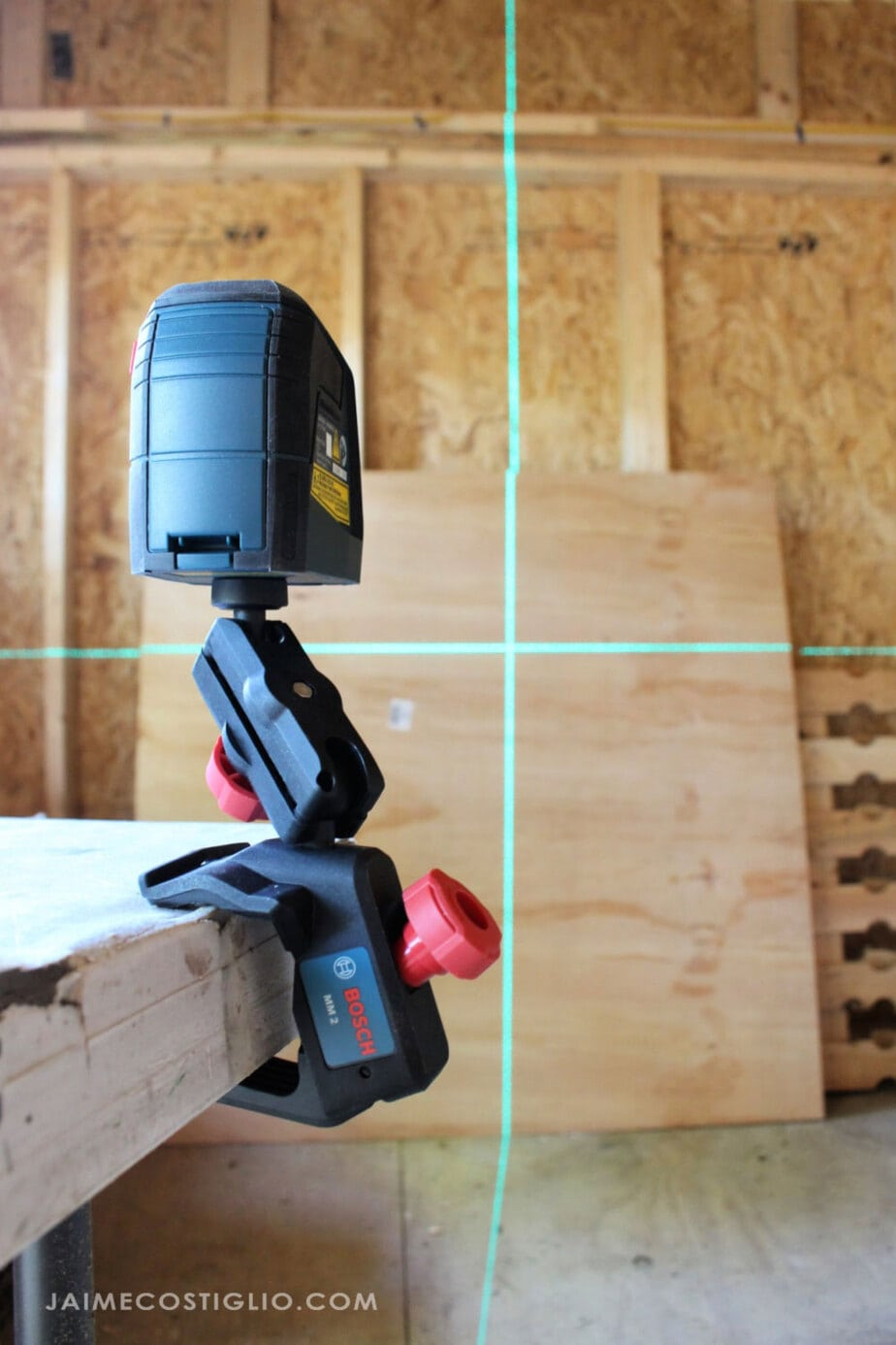 bosch laser level secured to table