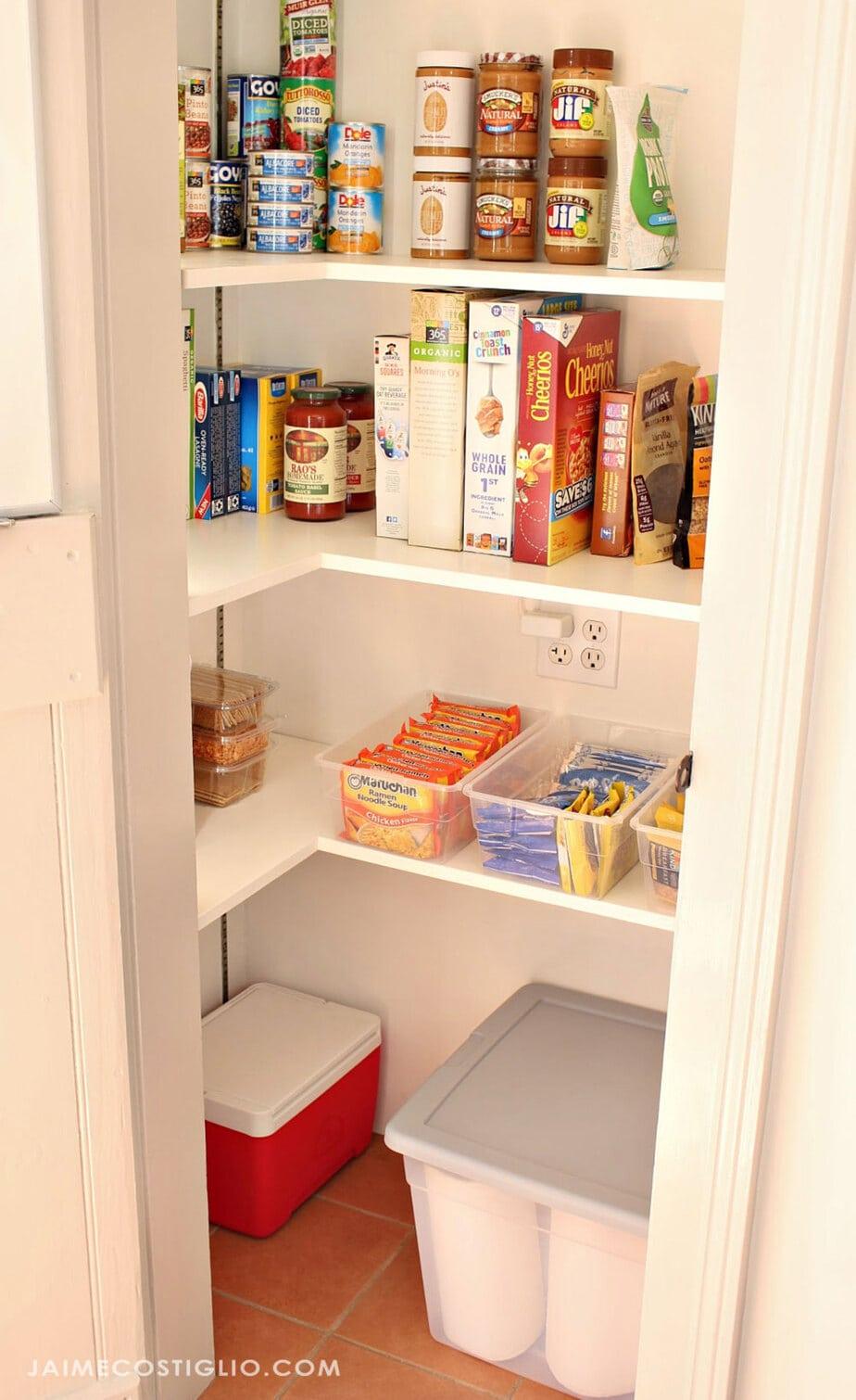plastic storage bins in pantry