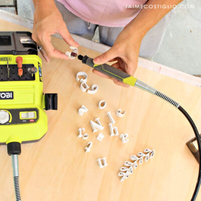 using rotary tool to sand letters