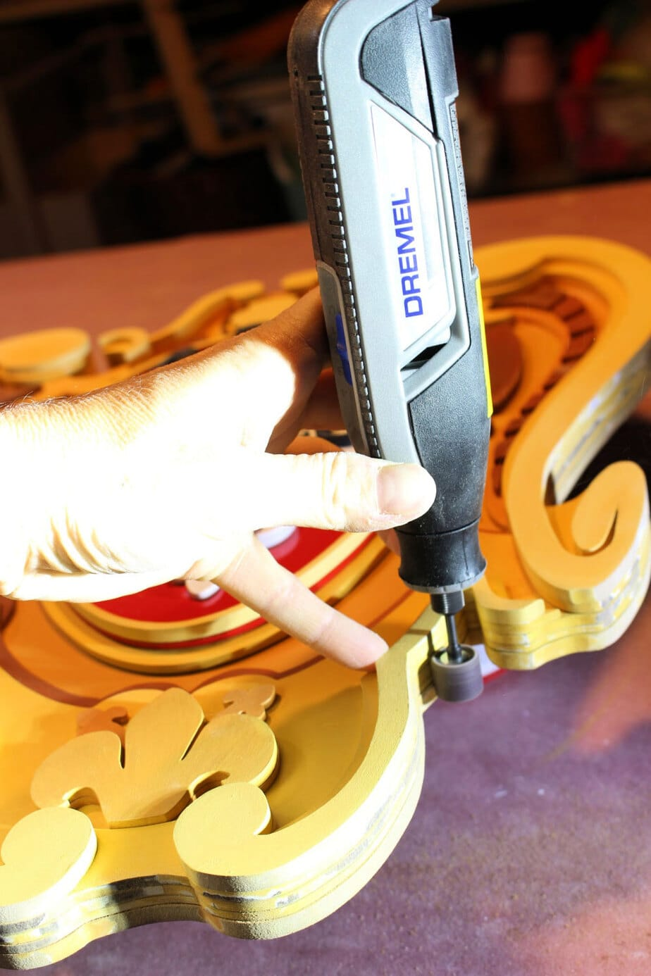 sanding detailed area with dremel lite