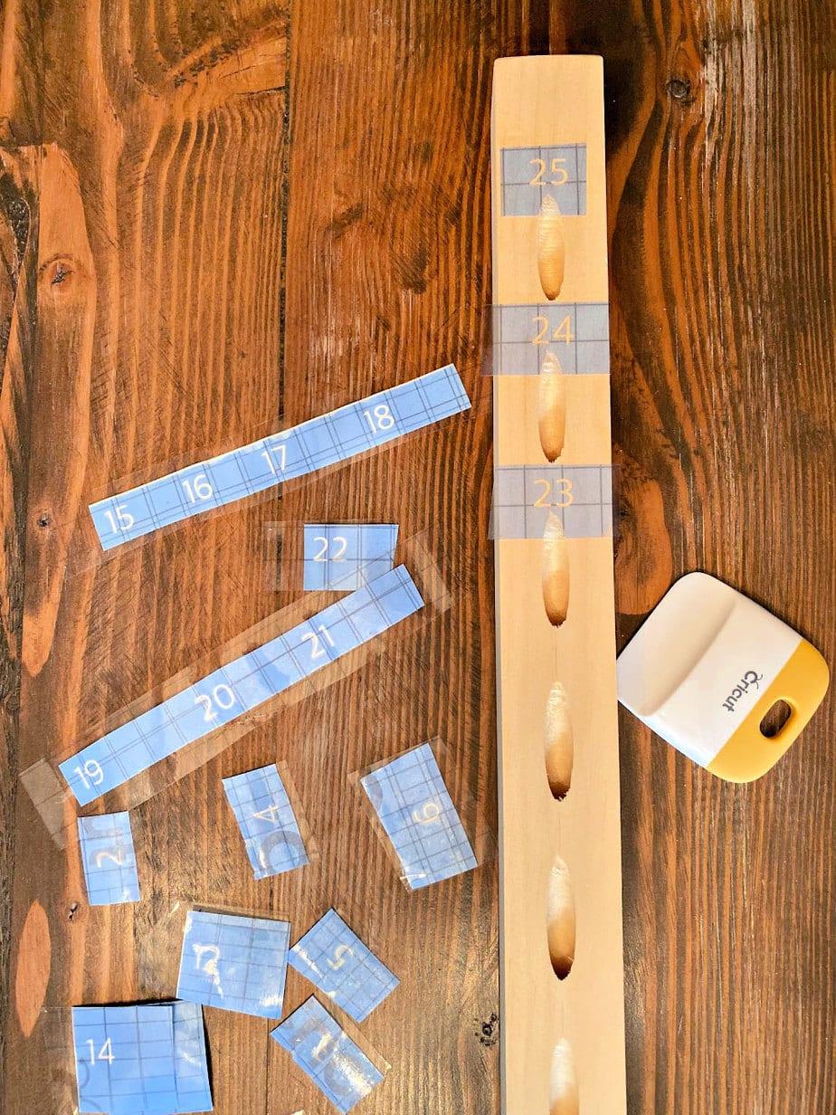 cricut vinyl pattern applied to wood