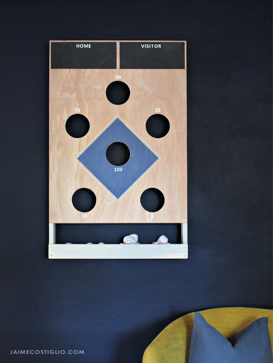 beanbag toss game mounted on wall