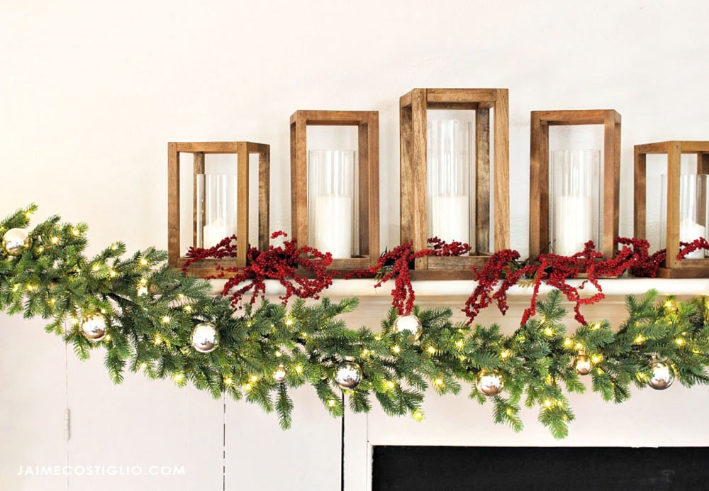 garland and wood lanterns