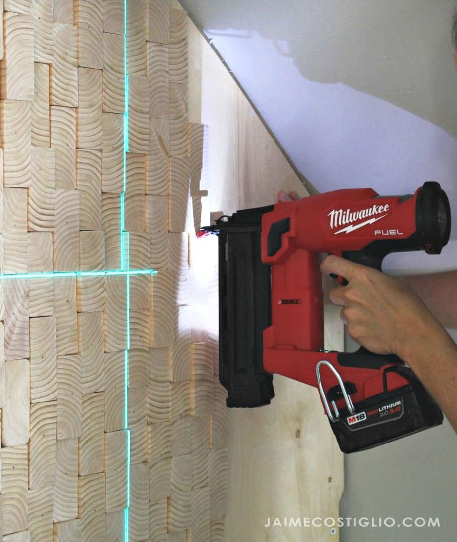 brad nailer on scrap wood wall