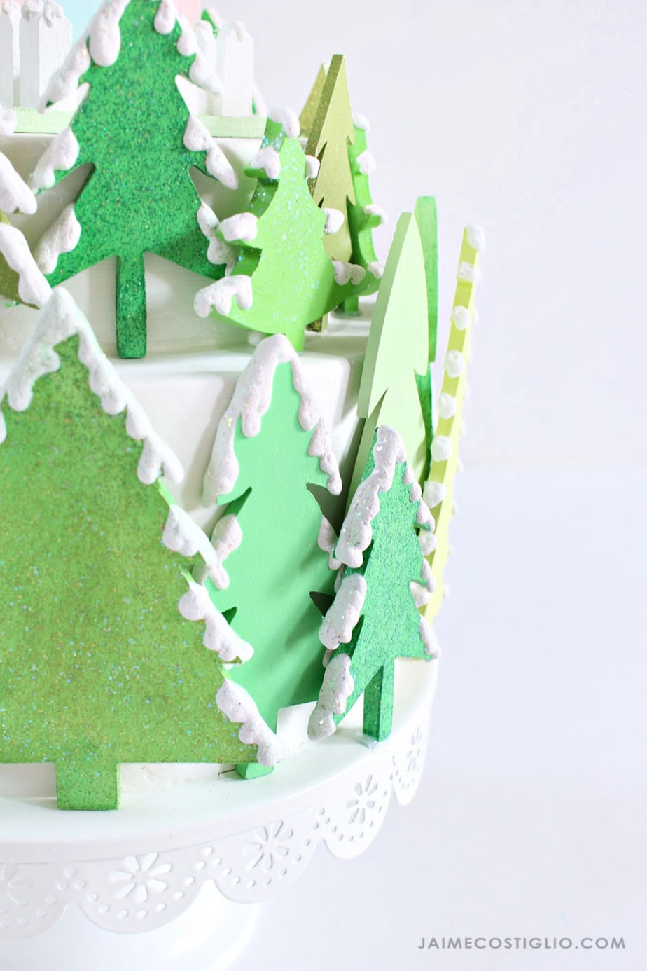 painted wood trees with snow and glitter
