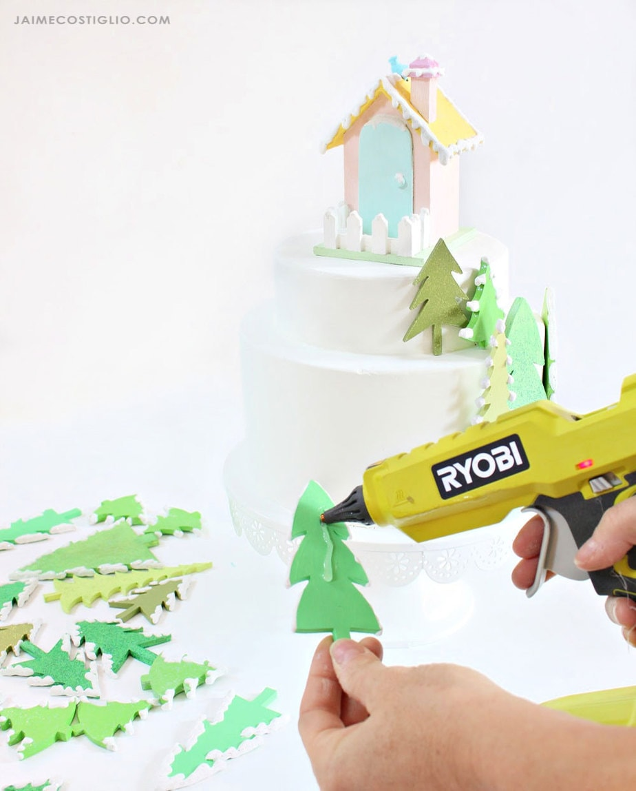 hot glue wood trees onto fake cake