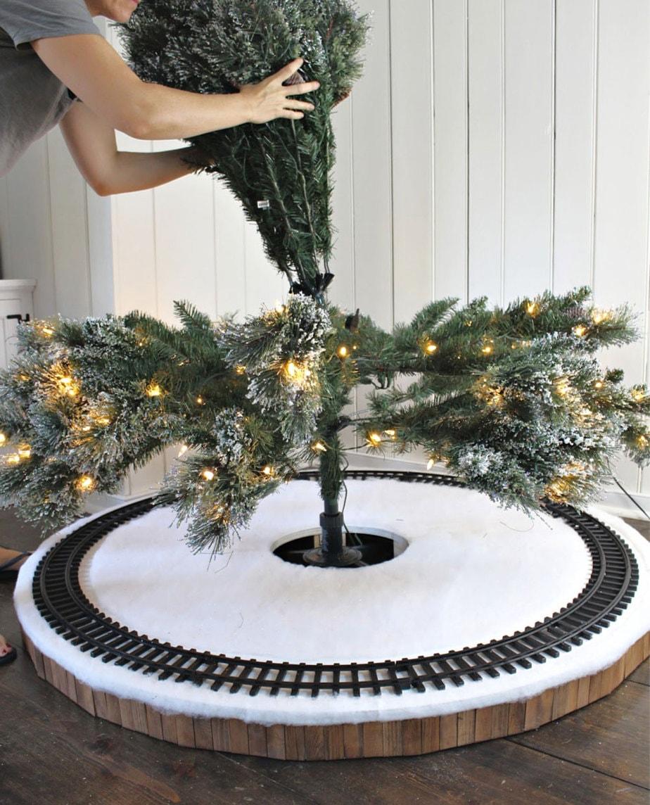 assembling fake tree inside tree skirt