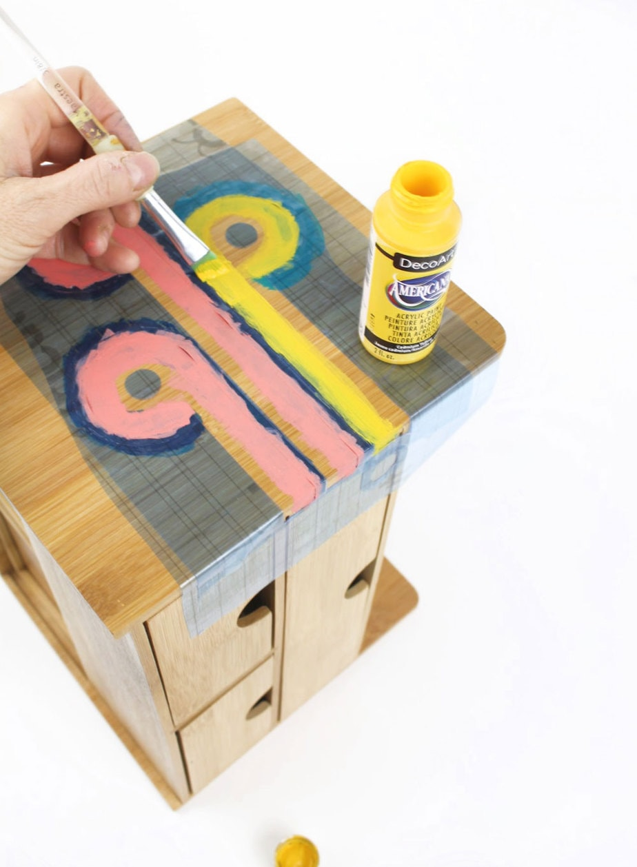 applying decoart americana paint to wood organizer