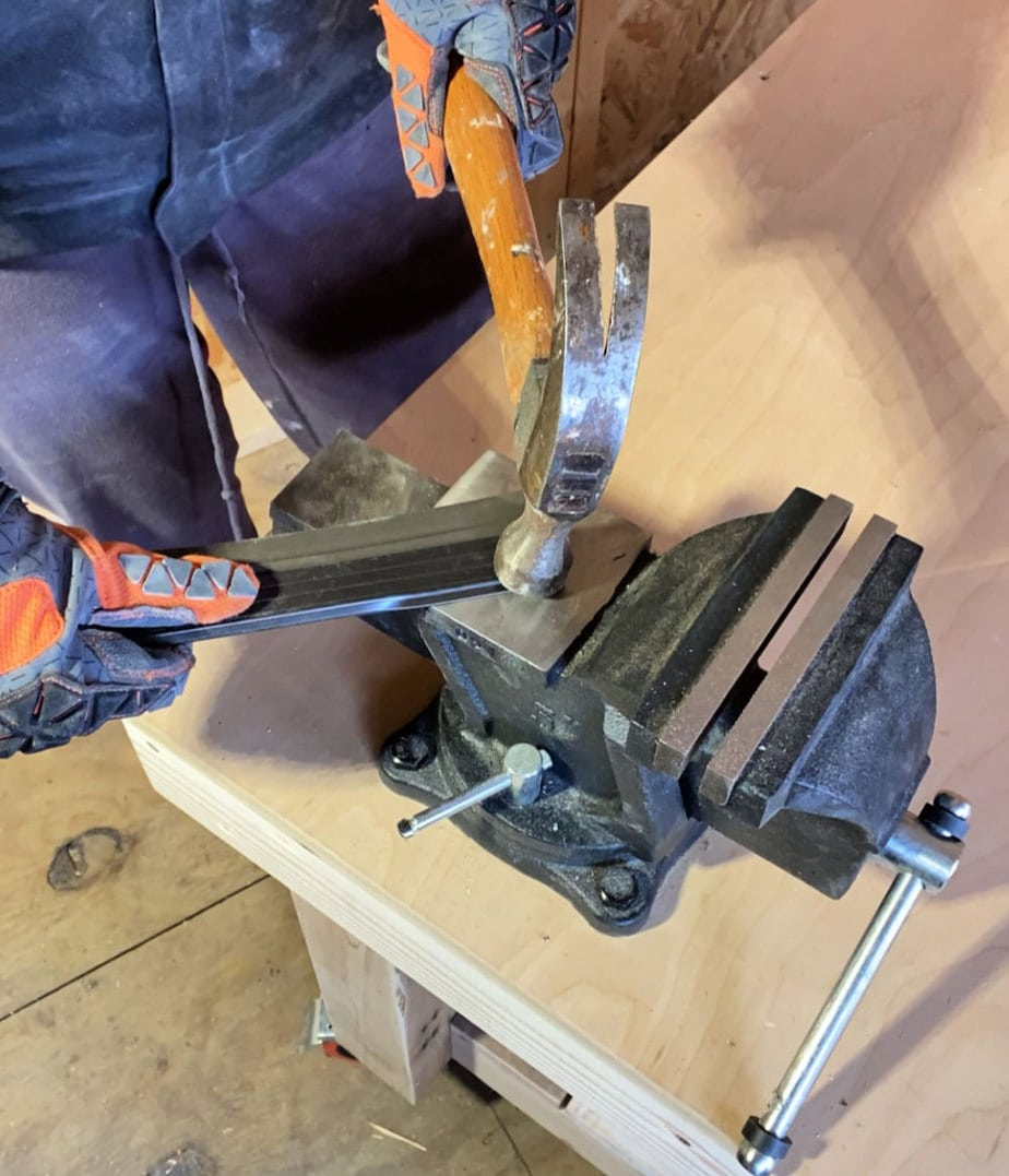hammering on vise anvil