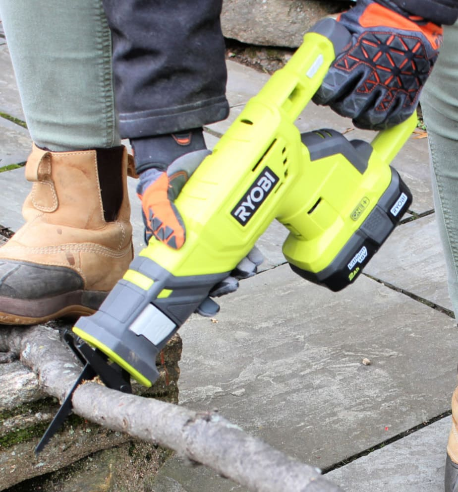 work gloves holding power tool