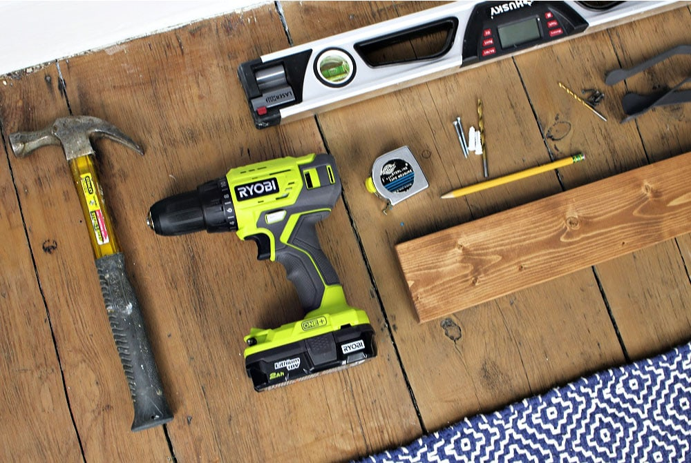 ryobi drill with supplies to hang hooks