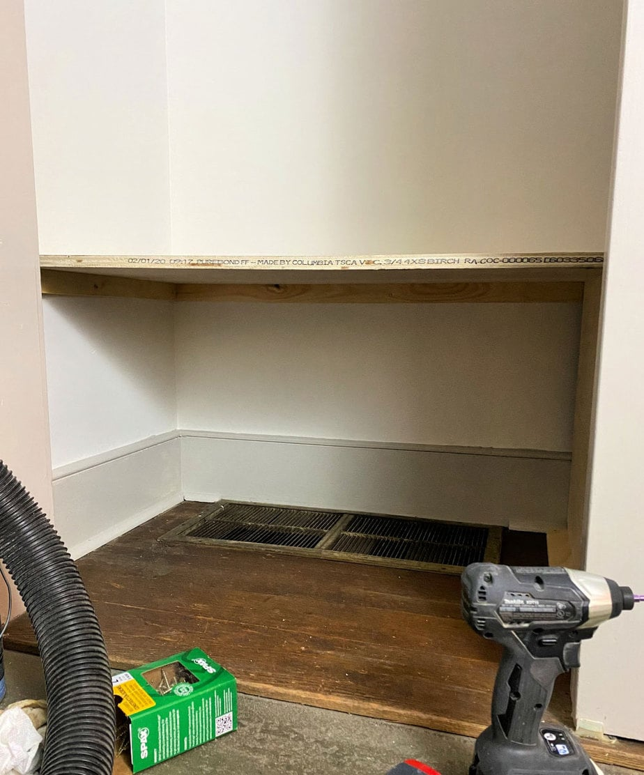 plywood shelf installed in closet