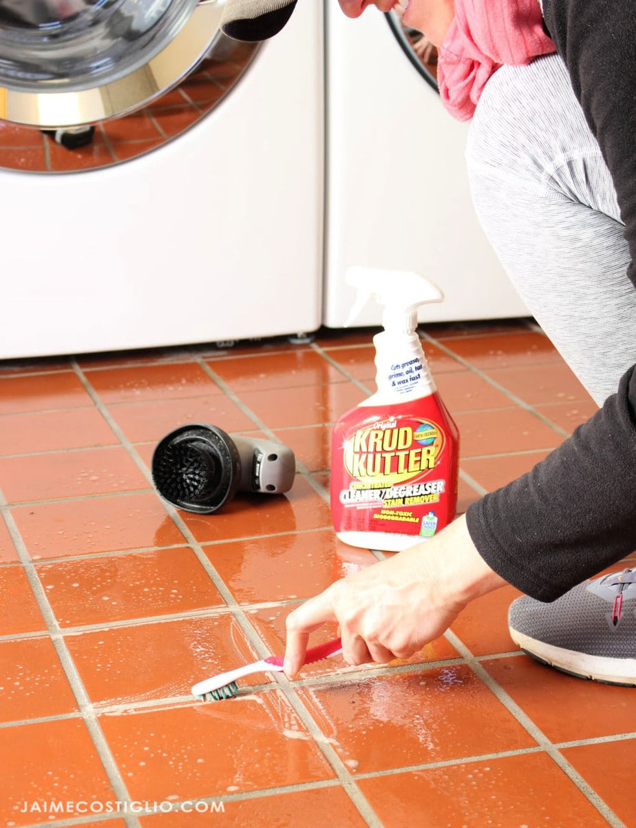 cleaning grout with toothbrush