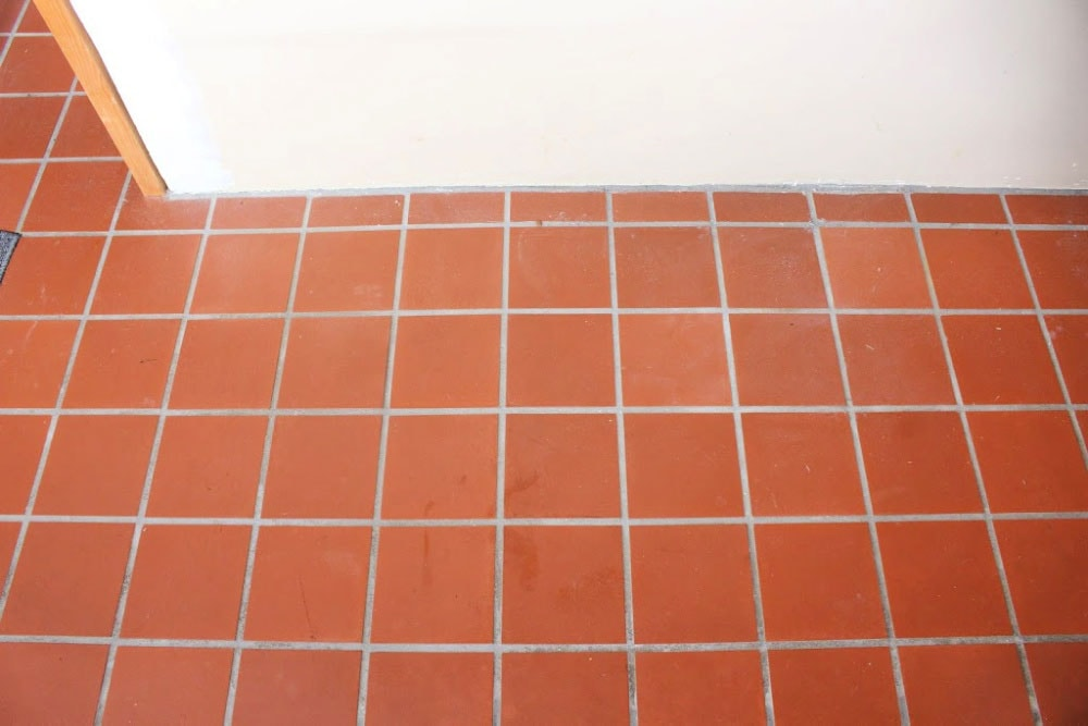 laundry room orange tile floor