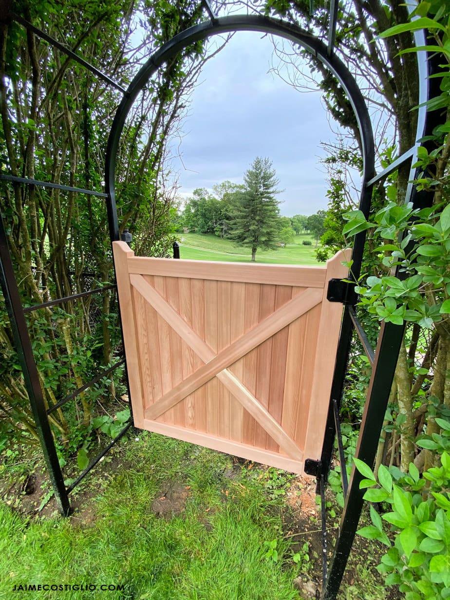 cedar gate with metal arch